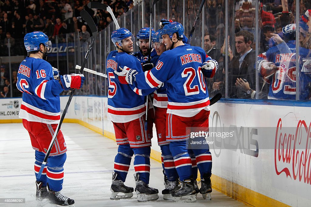 Jesper Fast #19, Chris Kreider #20, Keith Yandle #93, Dan Girardi #5 and Derick Brassard #16 of the New York Rangers celebrate after a third period goal against the San Jose Sharks at Madison Square Garden on October 19, 2015 in New York City.