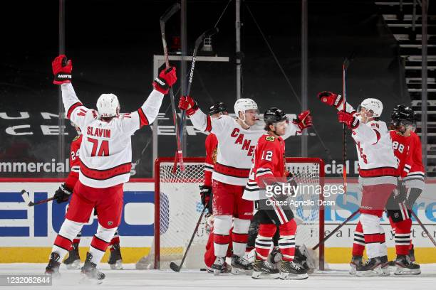 Jesper Fast of the Carolina Hurricanes celebrates with Jaccob Slavin and Sebastian Aho after scoring a goal in the third period against the Chicago...