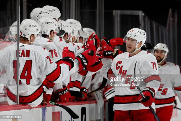 Jesper Fast of the Carolina Hurricanes celebrates with teammates after scoring a goal in the third period against the Chicago Blackhawks at the...