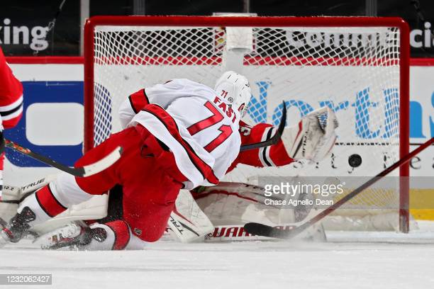 Jesper Fast of the Carolina Hurricanes scores a goal past Kevin Lankinen of the Chicago Blackhawks in the third period at the United Center on April...