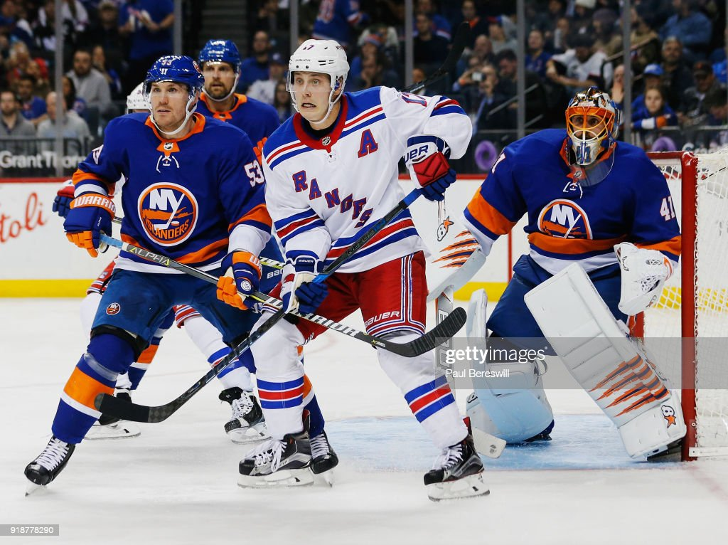 Jesper Fast #17 of the New York Rangers and Casey Cizikas #53 of the New York Islanders battle in front of the net defended by Jaroslav Halak #41 during the second period at Barclays Center on February 15, 2018 in the Brooklyn borough of New York City.