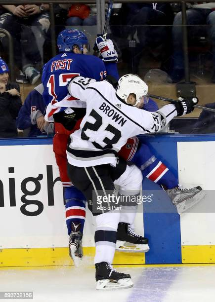 Jesper Fast of the New York Rangers and Dustin Brown of the Los Angeles Kings collide in the third period during their game at Madison Square Garden...