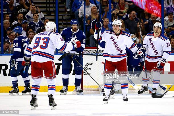 Jesper Fast of the New York Rangers celebrates with teammate Keith Yandle after scoring a goal in the second period against Ben Bishop of the Tampa...