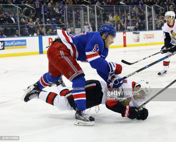 Jesper Fast of the New York Rangers hits Derick Brassard of the Ottawa Senators during the first period at Madison Square Garden on November 19 2017...