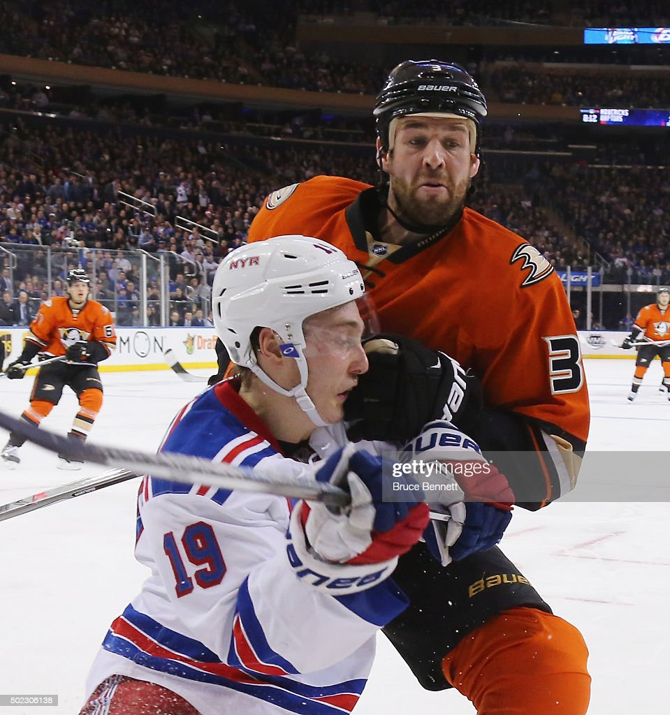Jesper Fast #19 of the New York Rangers is hit by Clayton Stoner #3 of the Anaheim Ducks at Madison Square Garden on December 22, 2015 in New York City. The Rangers defeated the Ducks 3-2 in overtime.