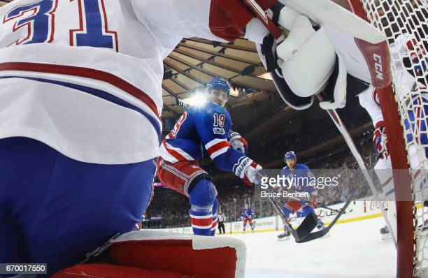 Jesper Fast of the New York Rangers scores in the first period against Carey Price of the Montreal Canadiens in Game Four of the Eastern Conference...