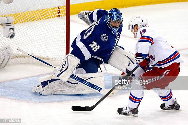 Jesper Fast of the New York Rangers scores the second goal in the first period against Ben Bishop of the Tampa Bay Lightning during Game Three of the...