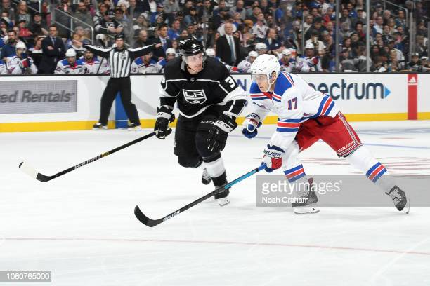 Jesper Fast of the New York Rangers skates against Dion Phaneuf of the Los Angeles Kings at STAPLES Center on October 28, 2018 in Los Angeles,...