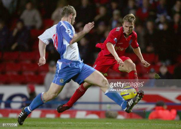 Jesper Gronkjaer of Birmingham City gets in a shot ahead of Andy Todd of Blackburn Rovers during the Barclays Premiership match between Blackburn...
