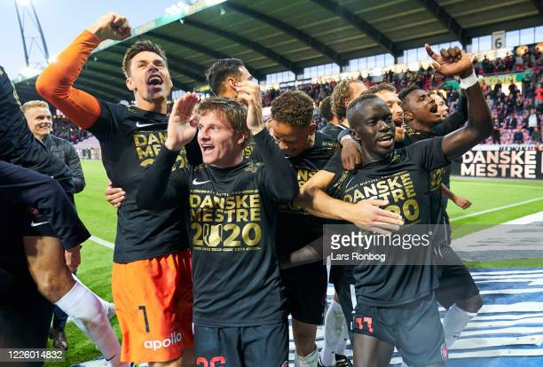 Jesper Hansen, Anders Dreyer, Mikael Anderson and Awer Mabil of FC Midtjylland celebrate as danish champions after the Danish 3F Superliga match...
