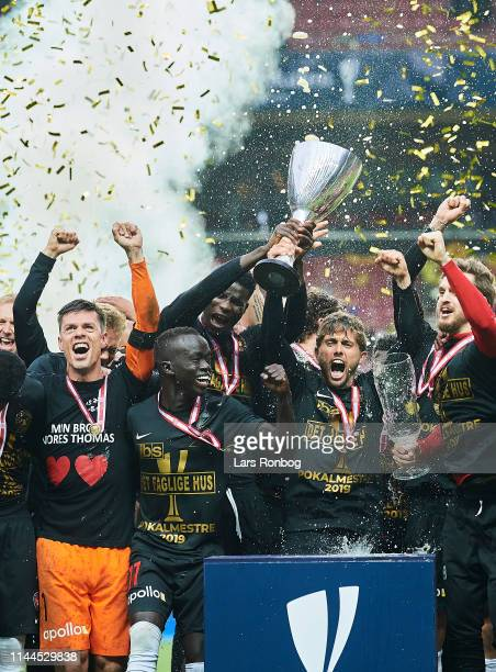 Jesper Hansen Awer Mabil Paul Onuachu and Jakob Poulsen of FC Midtjylland lifting the trophy as cup winners after the Danish Cup Final Sydbank...