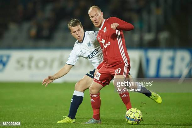 Jesper Juelsgard of AGF Arhus and Mikkel Rygaard of Lyngby BK compete for the ball during the Danish Alka Superliga match between AGF Arhus and...