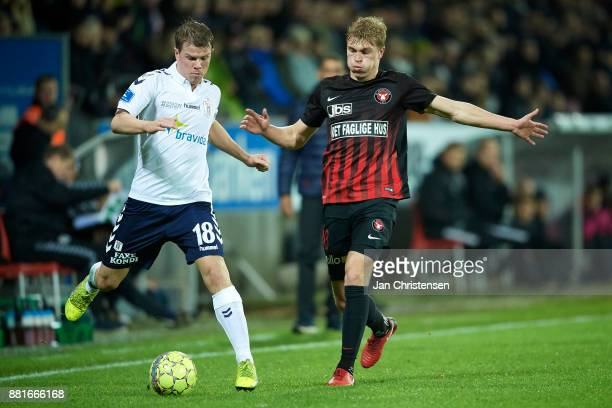 Jesper Juelsgard of AGF Arhus and Rasmus Nissen of FC Midtjylland compete for the ball during the Danish Alka Superliga match between FC Midtjylland...