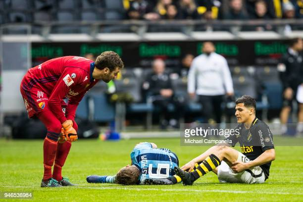 Jesper Karlstrom of Djurgardens IF injured after colliding with Tarik Elyounoussi of AIK during an Allsvenskan match between AIK and Djurgardens IF...