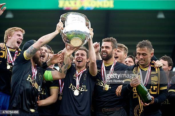 Jesper Lauridsen of FC Midtjylland celebrates and lifts the Alka Superliga Trophy as Danish Champions after the Danish Alka Superliga match between...