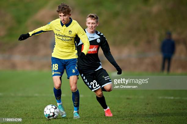 Jesper Lindstrom of Brondby IF and Emil Frederiksen of SonderjyskE compete for the ball during the testmatch between Brondby IF and SonderjyskE at...
