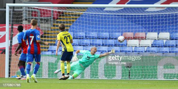 Jesper Lindstrom of Brondby IF beats Vincente Guaita of Crystal Palace to score a goal during a Pre-Season Friendly match between Crystal Palace and...