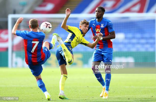 Jesper Lindstrom of Brondby IF is tackled by Max Meyer of Crystal Palace during a Pre-Season Friendly match between Crystal Palace and Brondby IF at...