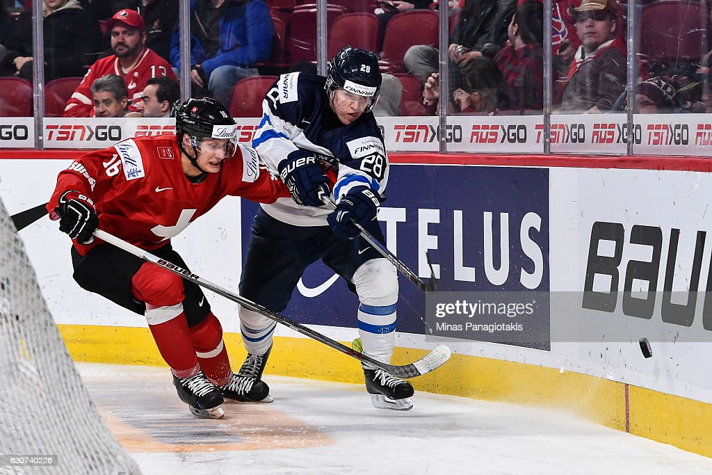 Jesper Mattila #28 of Team Finland clears the puck away from Loic In-Albon #16 of Team Switzerland during the 2017 IIHF World Junior Championship preliminary round game at the Bell Centre on December 31, 2016 in Montreal, Quebec, Canada. Team Finland defeated Team Switzerland 2-0.