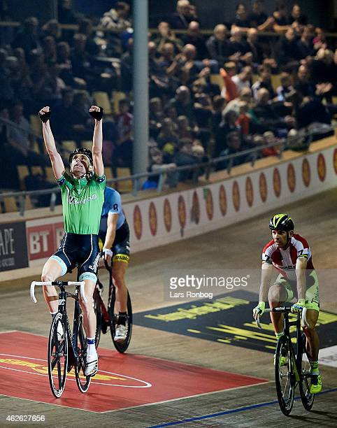 Jesper Morkov of Denmark celebrate his win in the madison watched by his brother Michael during the Copenhagen Six Days Cycling Race at Ballerup...