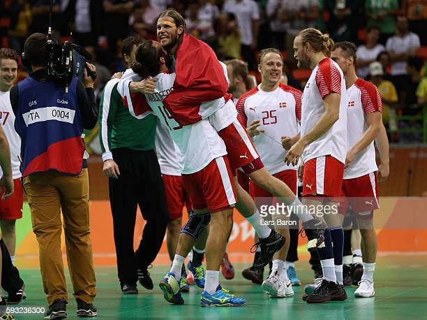 Jesper Noddesbo and Mikkel Hansen of Denmark celebrate after defeating France 2826 to win the gold medal in Men's Handball on Day 16 of the Rio 2016...