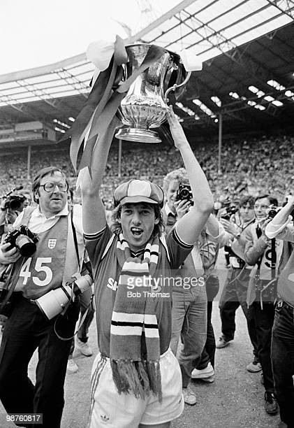 Jesper Olsen of Manchester United holds the FA Cup aloft during the lap of honour after his team's victory over Everton in the FA Cup Final held at...