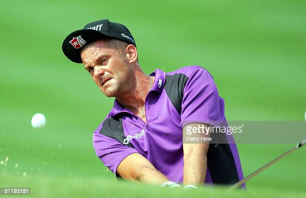 Jesper Parnevik of Sweden hits from the bunker on the 2nd hole during the first round of the NEC Invitational at the Firestone Country Club on August...