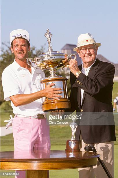 Jesper Parnevik of Sweden is given the championship trophy by Byron Nelson following his victory in the final round of the GTE Byron Nelson Classic...