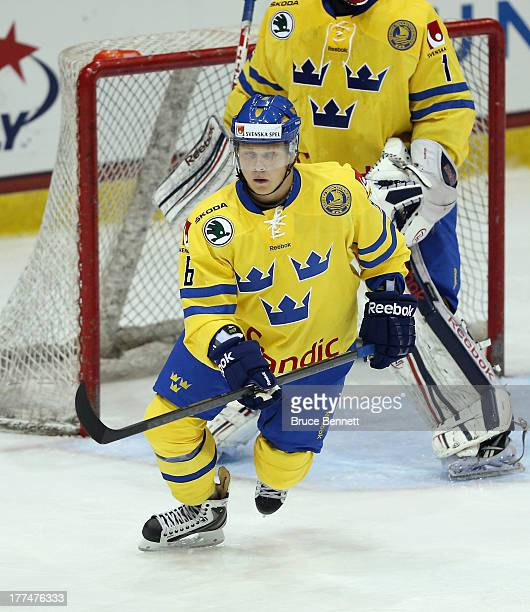 Jesper Pettersson of Team Sweden skates against Team USA during the 2013 USA Hockey Junior Evaluation Camp at the Lake Placid Olympic Center on...