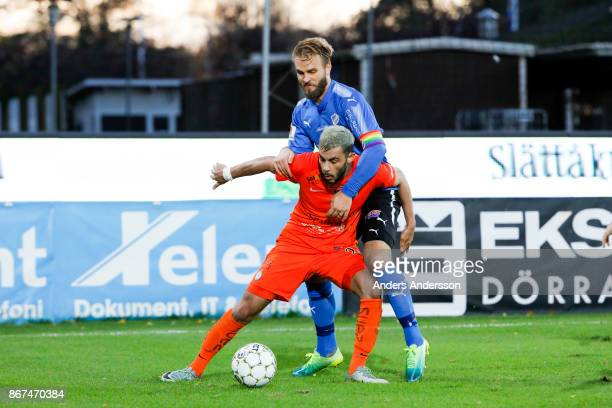 Jesper Westerberg of Halmstad BK and Farshad Noor of Athletic FC Eskilstuna compete for the ball during the Allsvenskan match between Halmstad BK and...