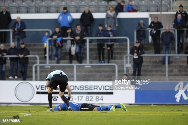Jesper Westerberg of Halmstad BK lays on the ground after a collision during the Allsvenskan match between Halmstad BK and Athletic FC Eskilstuna at...