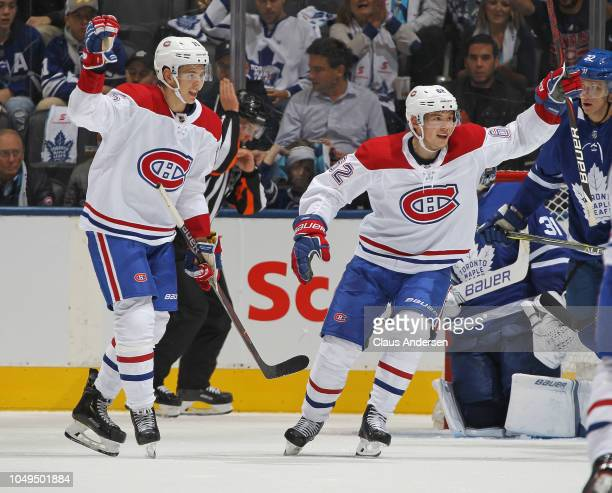 Jesperi Kotkaniemi and Artturi Lehkonen of the Montreal Canadiens celebrate a goal by teammate Andrew Shaw against the Toronto Maple Leafs during an...