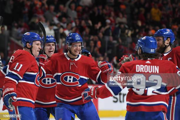 Jesperi Kotkaniemi Brendan Gallagher and Mike Reilly of the Montreal Canadiens celebrate after scoring a goal against the Colorado Avalanche in the...