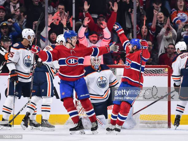 Jesperi Kotkaniemi of the Montreal Canadiens celebrates a third period goal with teammate Tomas Tatar against the Edmonton Oilers during the NHL game...