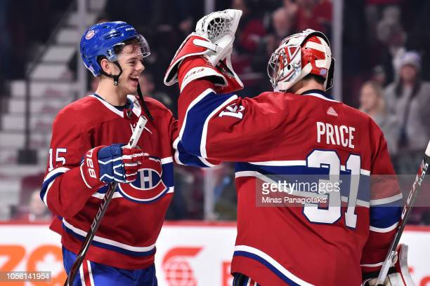 Jesperi Kotkaniemi of the Montreal Canadiens celebrates a victory with goaltender Carey Price against the Washington Capitals during the NHL game at...