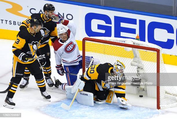 Jesperi Kotkaniemi of the Montreal Canadiens celebrates his goal as Matt Murray of the Pittsburgh Penguins looks at the puck in Game One of the...