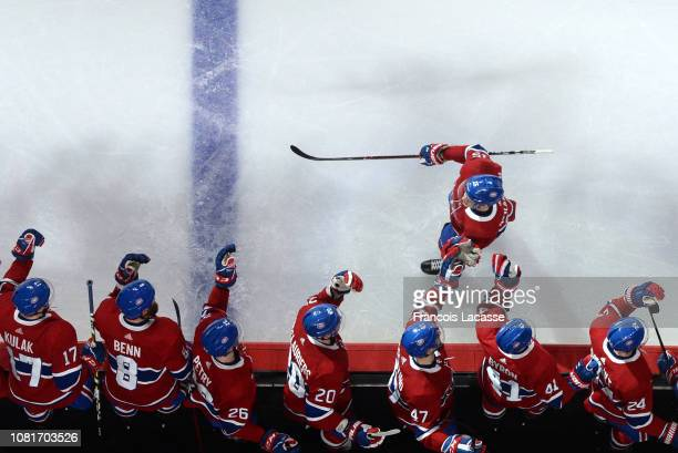 Jesperi Kotkaniemi of the Montreal Canadiens celebrates with the bench after scoring a goal against the Colorado Avalanche in the NHL game at the...