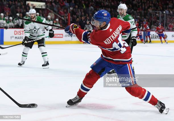 Jesperi Kotkaniemi of the Montreal Canadiens clears the puck against the Dallas Stars in the NHL game at the Bell Centre on October 30 2018 in...