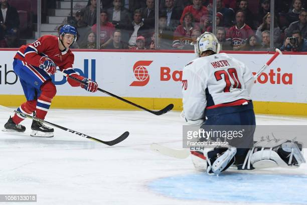 Jesperi Kotkaniemi of the Montreal Canadiens fires a shot to score his first NHL goal in the game against the Washington Capitalsat the Bell Centre...