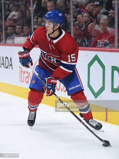 Jesperi Kotkaniemi of the Montreal Canadiens looks to pass the puck against the Detroit Red Wings in the NHL game at the Bell Centre on October 15...