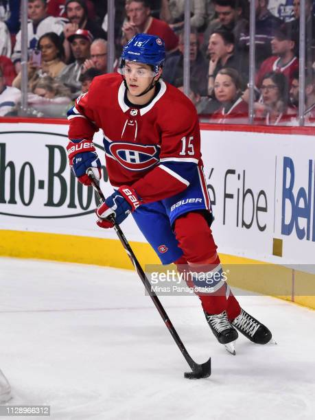 Jesperi Kotkaniemi of the Montreal Canadiens skates the puck against the Toronto Maple Leafs during the NHL game at the Bell Centre on February 9...