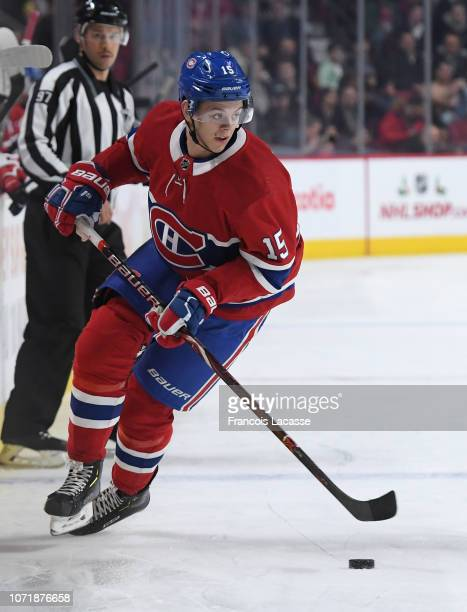 Jesperi Kotkaniemi of the Montreal Canadiens skates with the puck against the Washington Capitals in the NHL game at the Bell Centre on November 19...