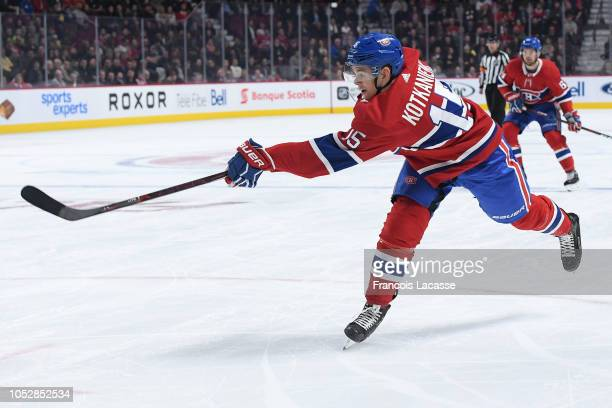 Jesperi Kotkaniemi of the Montreal Canadiens slaps a shot against the Calgary Flames in the NHL game at the Bell Centre on October 23 2018 in...