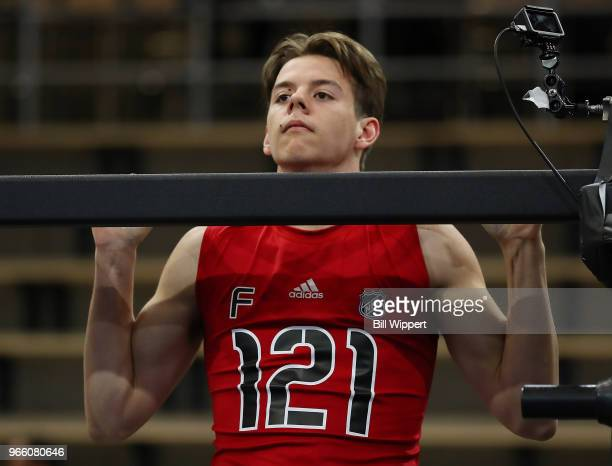 Jesperi Kotkaniemi performs pullups during the NHL Scouting Combine on June 2 2018 at HarborCenter in Buffalo New York
