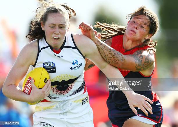 Jess Allan is bumped by Richelle Cranston of the Demons during the round two AFLW match between the Melbourne Demons and the Adelaide Crows at Casey...