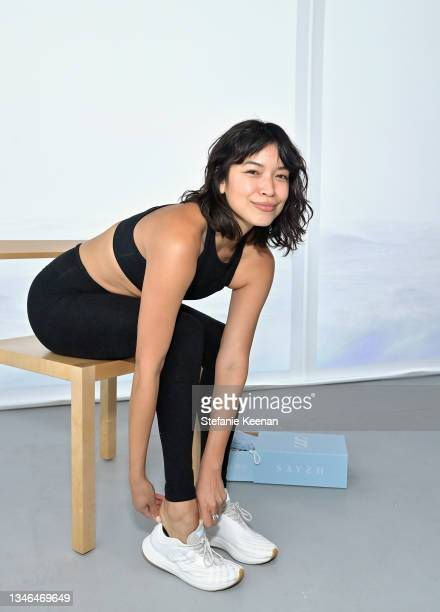 Jess Angeles attends a work out led by Megan Roup from The Sculpt Society as Olympian Allyson Felix opens Saysh's new experiential space on October...