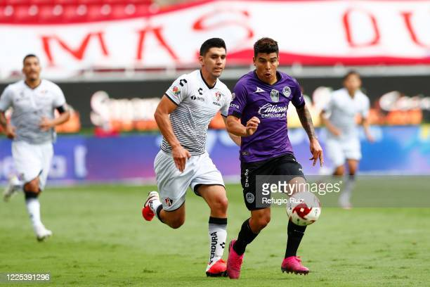 Jesús Angulo of Atlas fights for the ball with Angel Mendoza of Mazatlan during the match between Atlas and Mazatlan FC as part of the friendly...