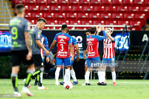 Jesús Angulo of Chivas celebrates with his teammates after scoring the second goal of his team during the match between Chivas and Atlas as part of...