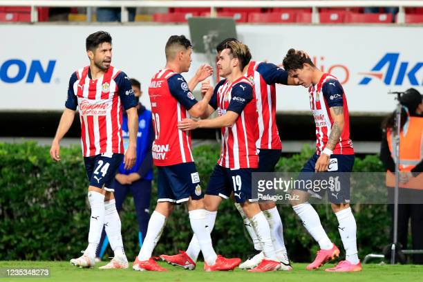 Jesús Angulo of Chivas celebrates with his teammates after scoring the first goal of his team during the 9th round match between Chivas and Pachuca...