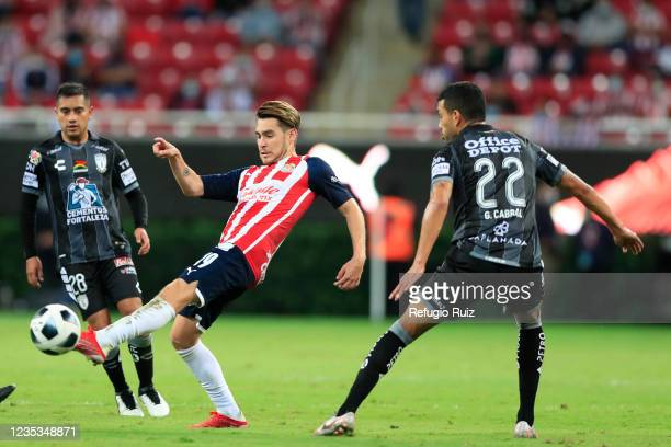 Jesús Angulo of Chivas fights for the ball with Erick Sánchez of Pachuca during the 9th round match between Chivas and Pachuca as part of the Torneo...